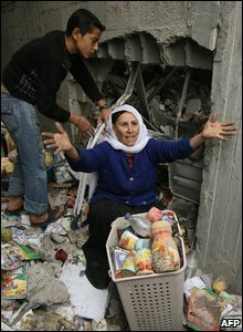Palestinians recover belongings and food from their destroyed house in Gaza's Jabalia refugee camp