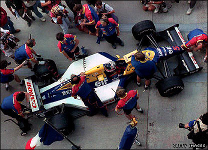 The pit crew get to work on Nigel Mansell's Williams-Renault in 1992