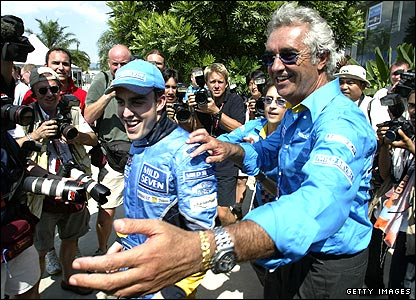Fernando Alonso and Renault team boss Flavio Briatore at the Malaysian Grand Prix in 2003