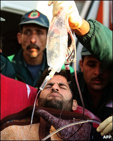 An injured Palestinian man is treated in Gaza