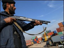 Pakistani soldier guards supplies in Peshawar