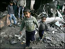 Palestinian children walk past a destroyed mosque in the northern Gaza Strip