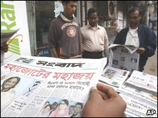 Reading the papers in Dhaka