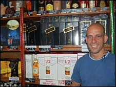 Alejandro Castro in his liquor store in Caracas