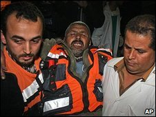 An injured Palestinian man is taken to hospital