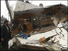 Hamas member surveys damage to offices of PM Ismail Haniya 31 Dec