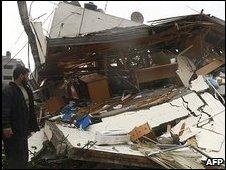 Hamas member surveys damage to offices of PM Ismail Haniya 31 Dec