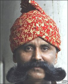 Lalan Singh, 40, a doorman for the Legend of India restaurant, poses with his stylised moustache