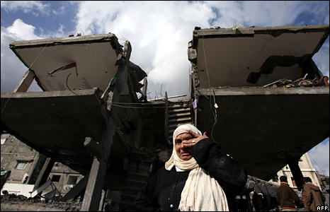 A woman cries in front of her destroyed house in the Jabalia refugee camp