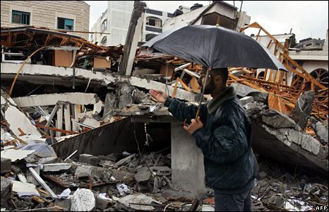 A Palestinian man inspects the remains of Ismail Haniya's compound in Gaza