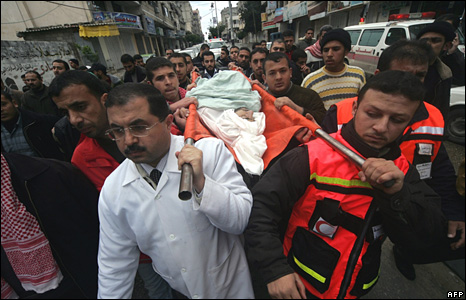 Palestinian doctors and medical workers carry the body of Ehab al-Madoun, a Palestinian doctor killed in an Israeli air strike, during his funeral in Gaza City