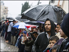 Palestinians queue up to buy bread outside a bakery in the Jabaliya refugee camp on 31 December 2008