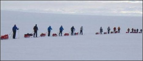 Competitors with sleds