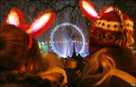 In London, revellers opposite the London Eye prepare to see in the New Year, 31 December 2008
