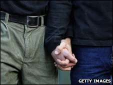 Gay men holding hands