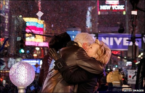 Bill and Hillary Clinton embrace in New York's Times Square