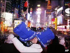A couple kiss in Times Square, New York