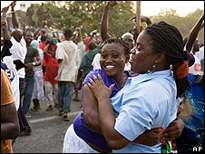 Opposition National Democratic Congress supporters hug