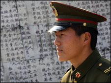 Chinese soldier visits war grave, China, Feb 07