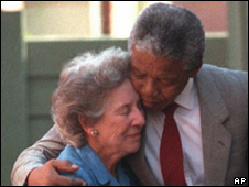 Suzman and Nelson Mandela outside his Soweto home in 1990