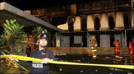 Police secure the site of a fire that ripped through Santika nightclub in Bangkok