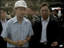 PM Vejjajiva, left, and police chief Gen. Wongsuwan inspect the site of the Santika nightclub