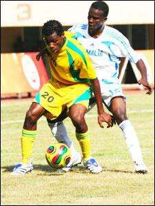Zanzibar's Juma Mohammed (front) and Somalia's Mohamed Ali compete for the ball