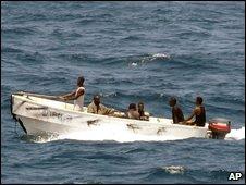 Pirates leave the Ukrainian merchant vessel MV Faina for Somalia's shore