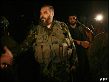 Nizar Rayyan speaks with Hamas fighters during training in the Jabaliya refugee camp on 14 September 2007