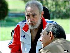 Fidel (L) and Raul Castro