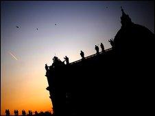 A sunset is seen behind St Peter's basilica at the Vatican, 24 December 2008