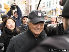 Madoff surrounded by media