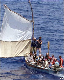 U.S. Coast Guard personnel approach a boat of Cuban refugees off the coast of Miami in 1999