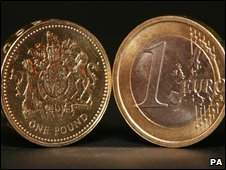 A one euro coin and a one pound coin