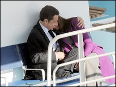 Ms Bruni gets a hug from her husband in London on 27 March 2008