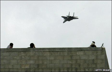 Israeli jet flies over Jabaliya during funeral from Nizar Rayan and family