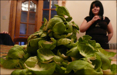 Woman with Brussel sprout peelings