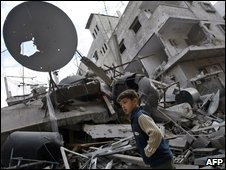 Palestinian boy in front of destroyed house in Gaza, 3 January