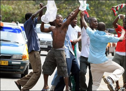 Supporters of John Atta Mills celebrate his election victory in Ghana