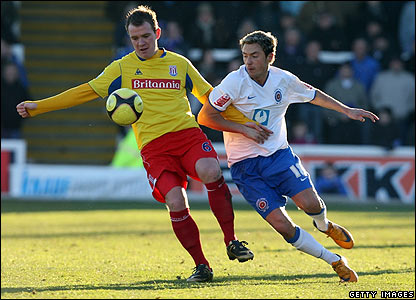 Glenn Whelan shields the ball from Hartlepool's Michael Mackay