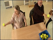 Patients use tennis balls for exercise