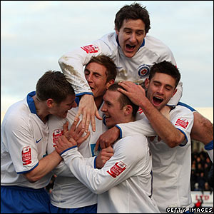 Hartlepool's David Foley is mobbed by his team-mates