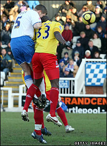 Michael Nelson powers a header into the bottom corner