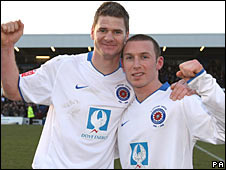 Goalscorers Michael Nelson and David Foley celebrate Hartlepool's victory over Stoke