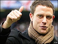 Wayne Bridge gives a thumbs-up after being unveiled as a Man City player
