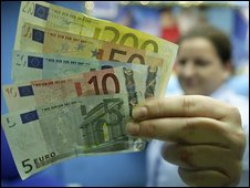 Worker holding Euro notes