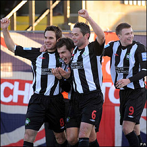 Alex Lawless is congratulated by his Forest Green team-mates