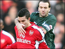 Arsenal's Robin van Persie is challenged by Plymouth's Karl Duguid