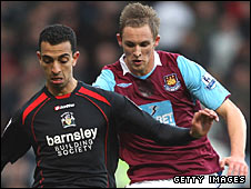 West Ham's Jack Collison challenges Mounir El Haimour of Barnsley