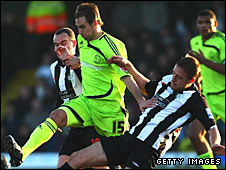 Derby's Luke Varney is challenged by Darran Kempson of Forest Green Rovers